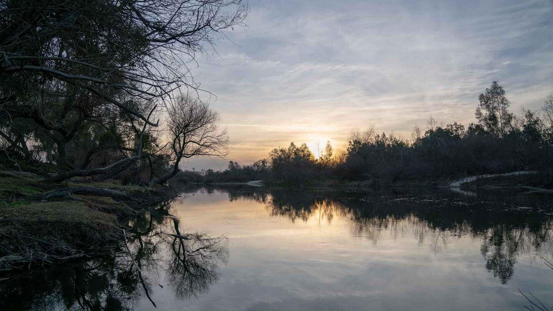 The sun setting on the San Joaquin River. | Carla Pineda