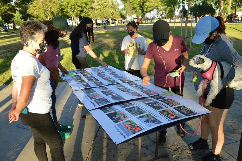 Locals gather around plans for a new arts center at an outdoor space