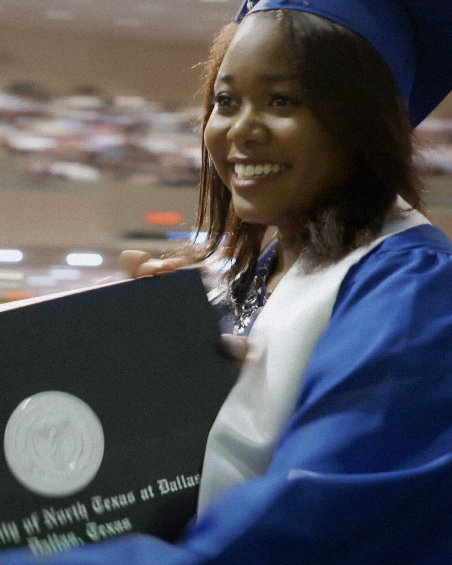 """Woman receiving a diploma at graduation ceremony.   Featured """"Global Mosaic"""" Image"""