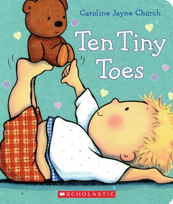 """Book Cover of """"Ten Tiny Toes"""" by Caroline Jayne Church. It is illustrated with a small child holding a teddy bear on his legs."""