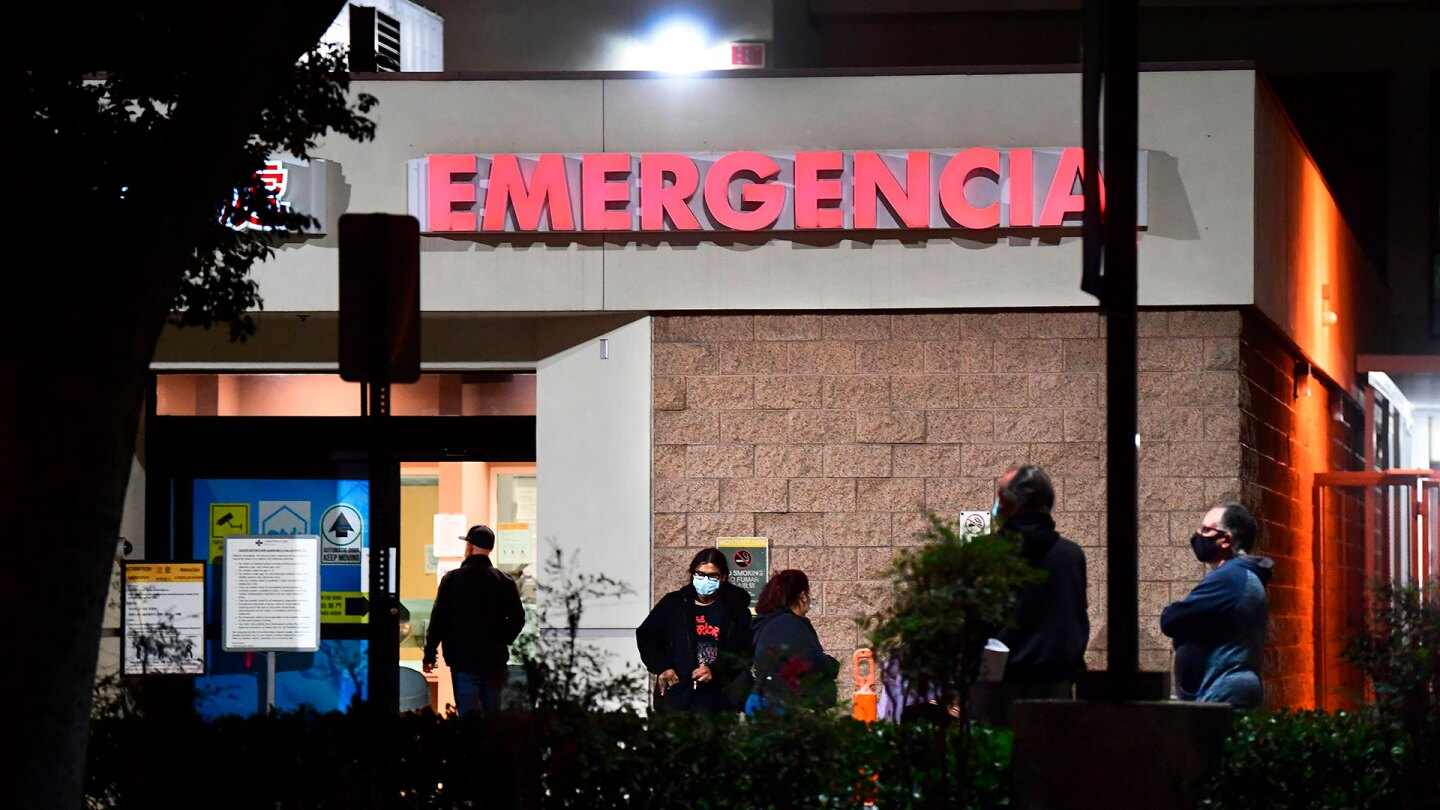 People wait outside the Emergency room of the Garfield Medical Center in Monterey Park, California on December 1, 2020. | FREDERIC J. BROWN/AFP via Getty Images