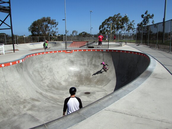 Ryann and her dad practicing in the bowl .