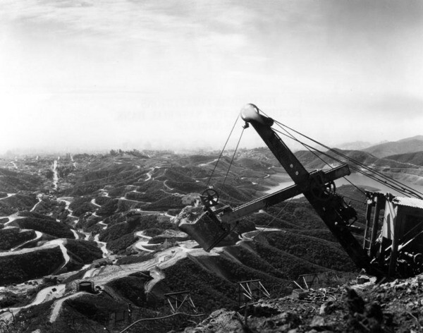 A steam shovel above the Hollywoodland Sign, circa 1926. Courtesy of the Security Pacific National Bank Collection - Los Angeles Public Library.