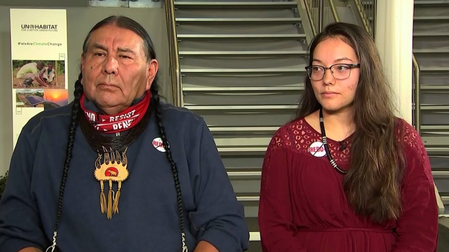 Tom Goldtooth, executive director of the Indigenous Environmental Network, and Isabella Zizi. | Democracy Now