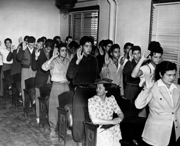 Original caption: ''Defendants and witnesses of the Sleepy Lagoon gang murder of Jose Diaz in an unusual mass oath-taking. Armed deputies guarded the inquest room.'' 1942. | Herald-Examiner Collection, Courtesy of the Los Angeles Public Library