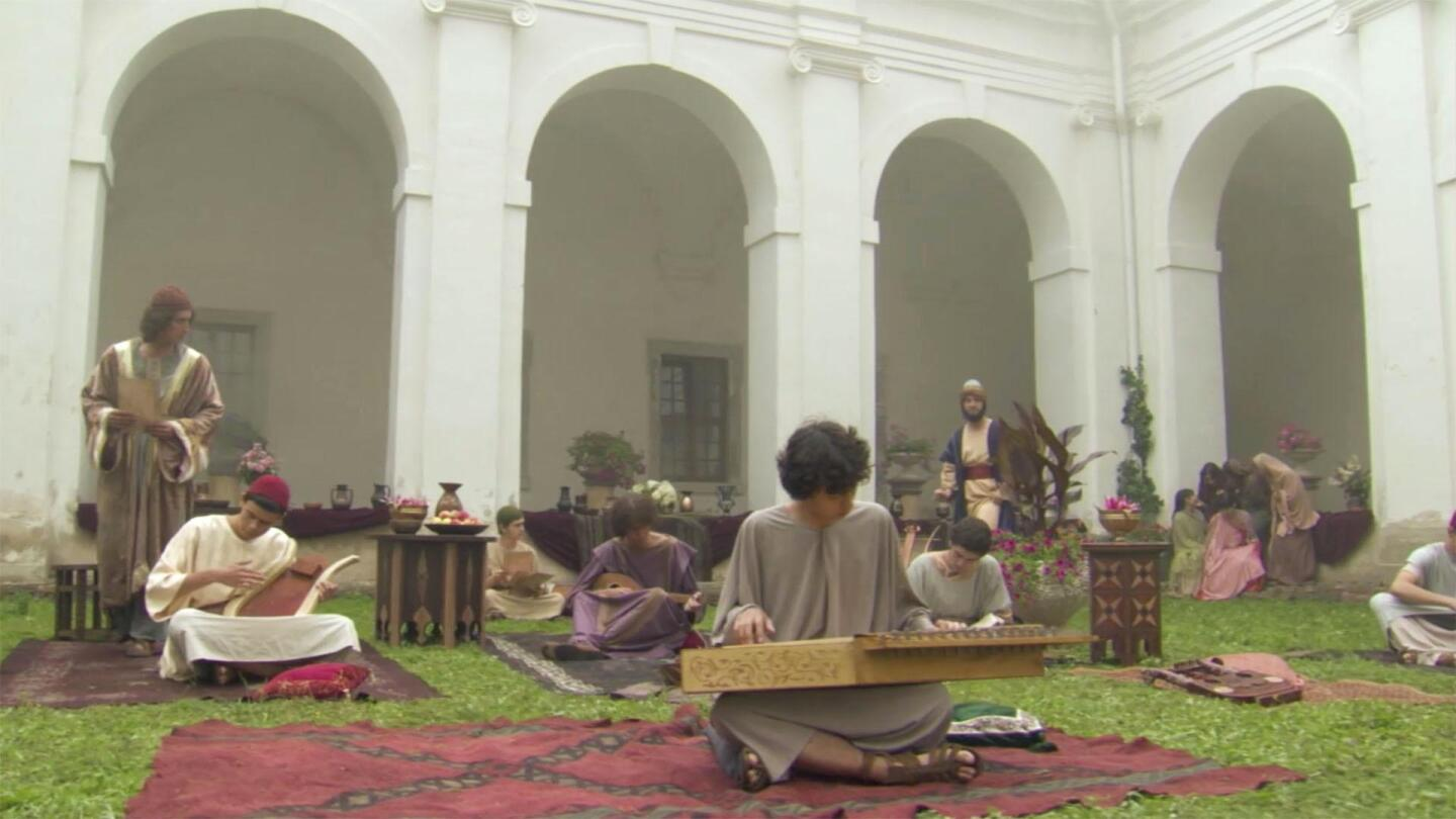 "People playing instruments in a courtyard. | ""Cities of Light: The Rise and Fall of Islamic Spain."""