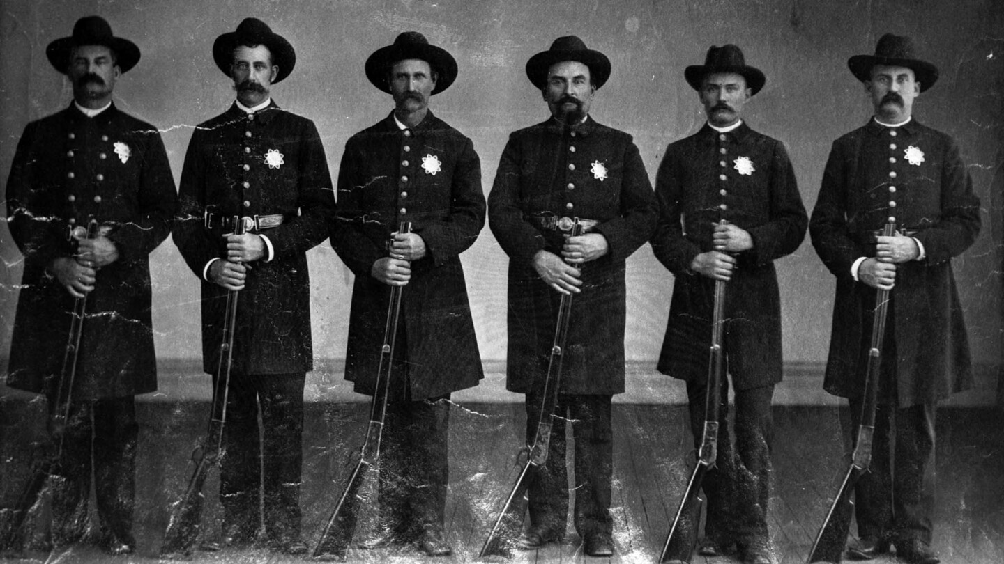 Portrait of the Los Angeles Police team, posing with rifles, 1890