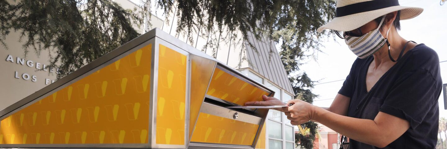 A voter places their ballot in a mail-in ballot dropoff box outside of a library ahead of Election Day on October 5, 2020 in Los Angeles, California. | Mario Tama/Getty Images