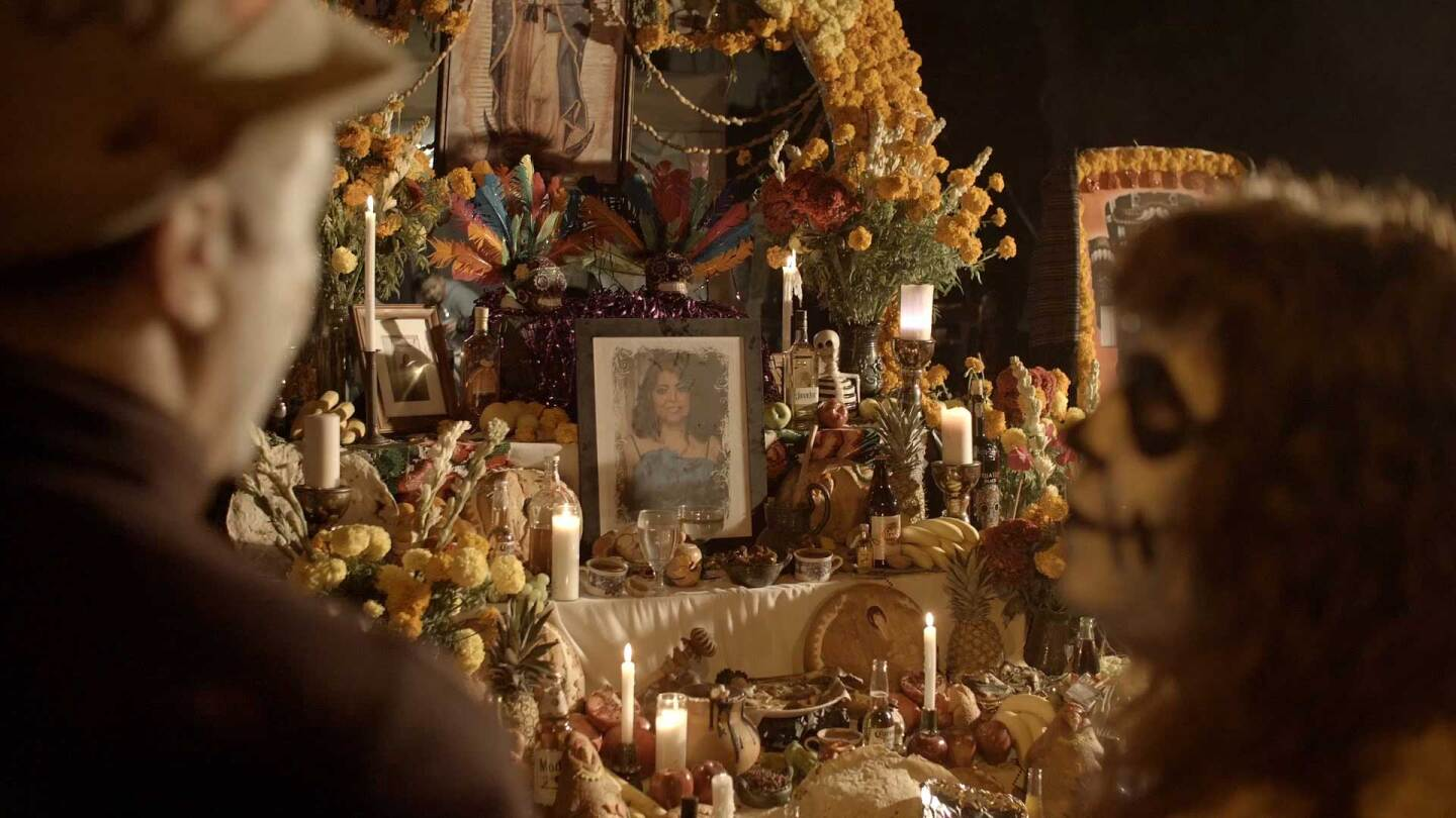 "Joseph Leahy in calavera and an altar in the background during Dia delos Muertos | Still from ""Artbound"" Dia delos Muertos / Day of the Dead"