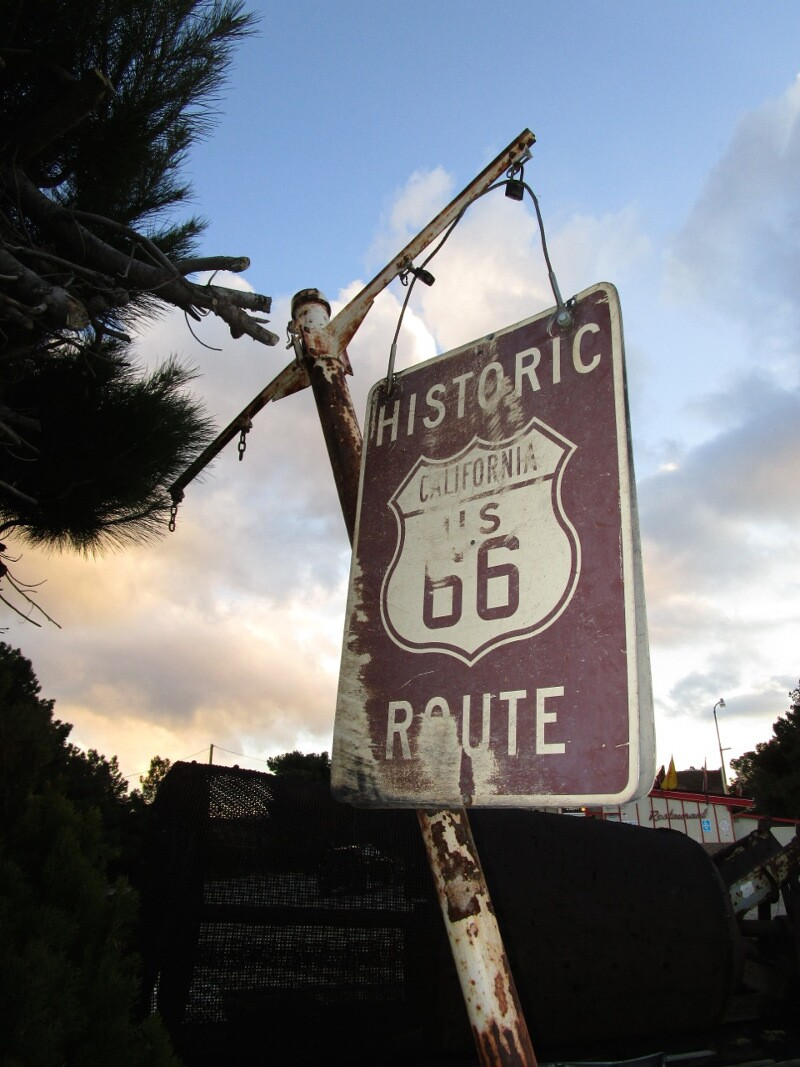 A faded Route 66 sign in front of historic Summit Inn diner, located at the southern end of the Cajon  Pass – the trail linking the desert with the California coast through San Bernardino.