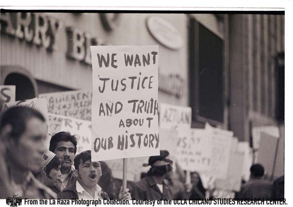 CSRC_LaRaza_B10F3C3_PA_003 Protester at immigration march against Dixon-Arnett Act | Pedro Arias, La Raza photograph collection. Courtesy of UCLA Chicano Studies Research Center