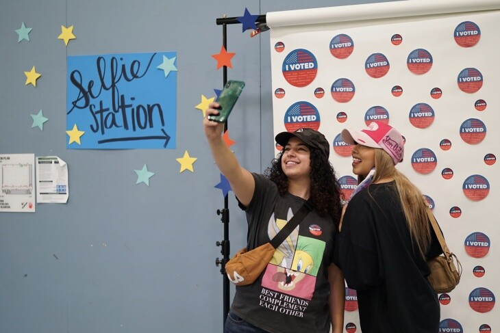 Ayah Alayanini and Jenny Zelaya take a post-voting selfie at the Santa Monica College vote center on Election Day, Tuesday, Nov. 3, 2020. | Al Kamalizad/LAist