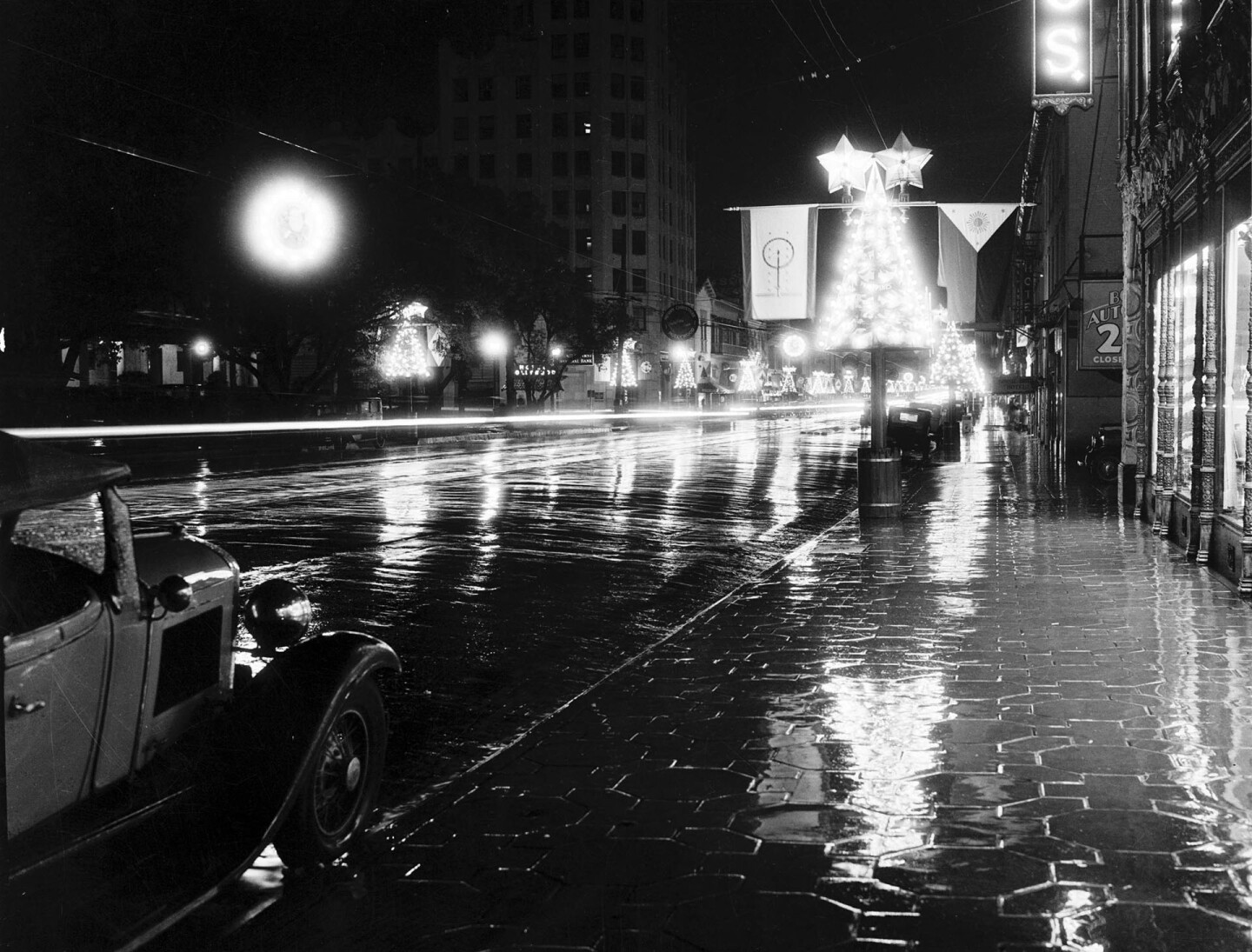 Circa 1935 view of a wet Hollywood Boulevard decorated for the holidays. Courtesy of the California Historical Society Collection, USC Libraries.