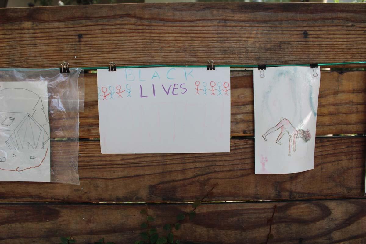 A Black lives matter drawing hangs on Dan Fields' Los Feliz fence gallery.