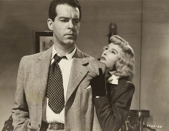 """Film Still for """"Double Indemnity """" (1944), © Paramount Pictures. Courtesy of the Margaret Herrick Library, Academy of Motion Picture Arts and Sciences. Shown from left: Fred MacMurray, Barbara Stanwyck.g"""