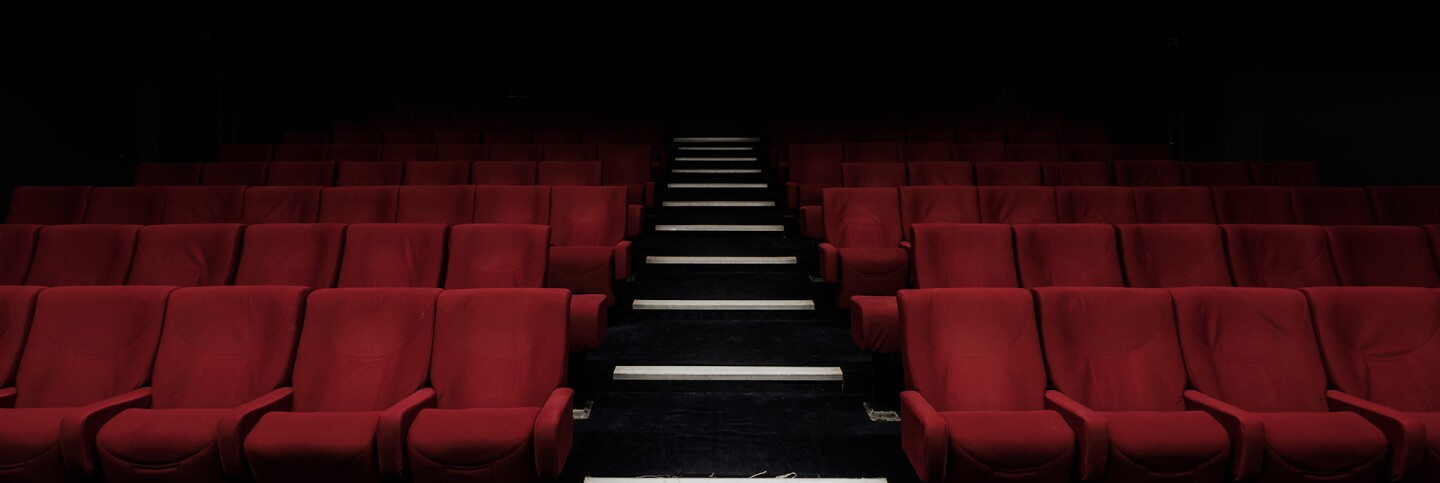 Empty red velvet chairs | Felix Mooneeram / Unsplash