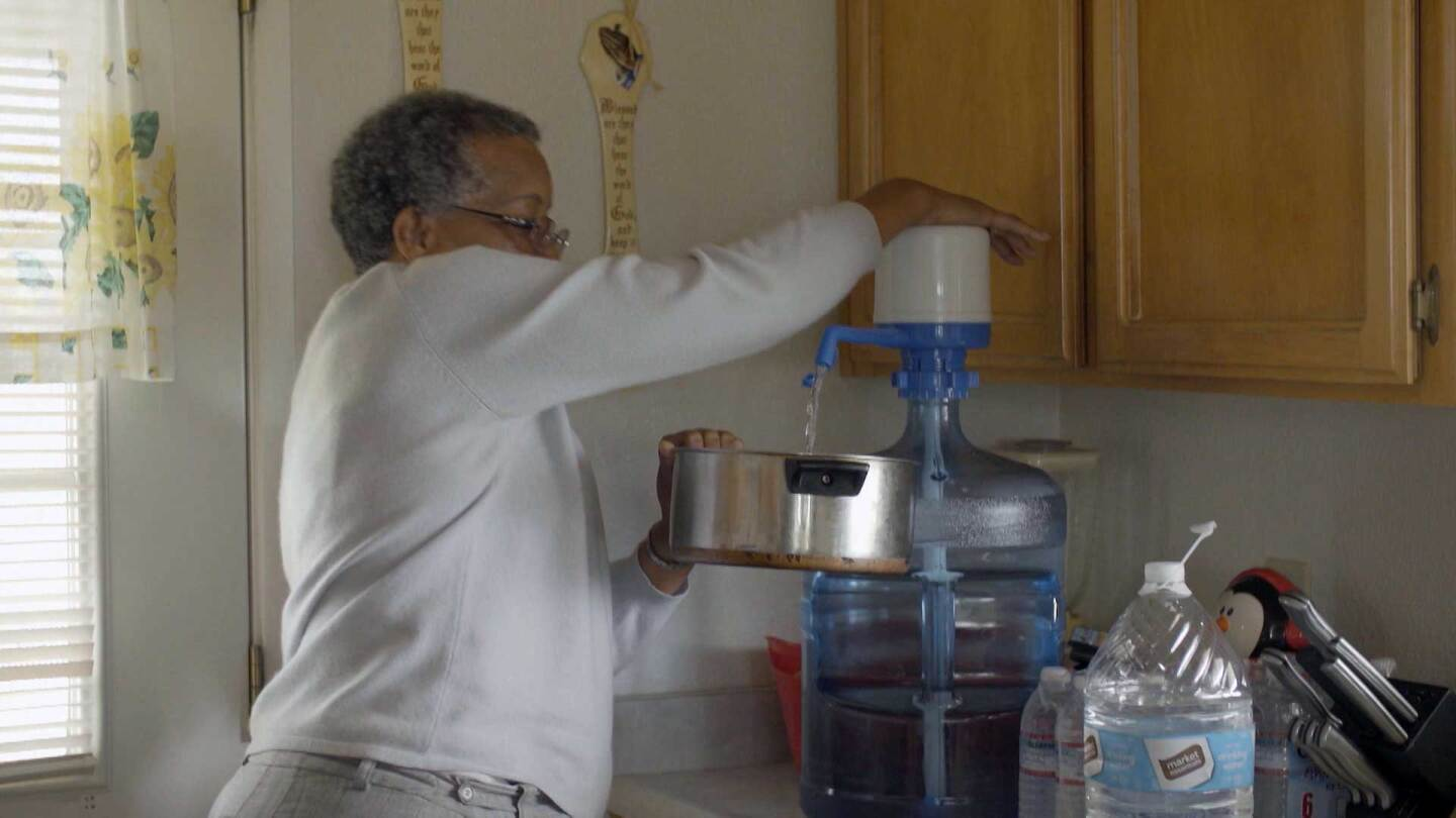 Allensworth resident Denise Hutson pumps water to cook. | Earth Focus