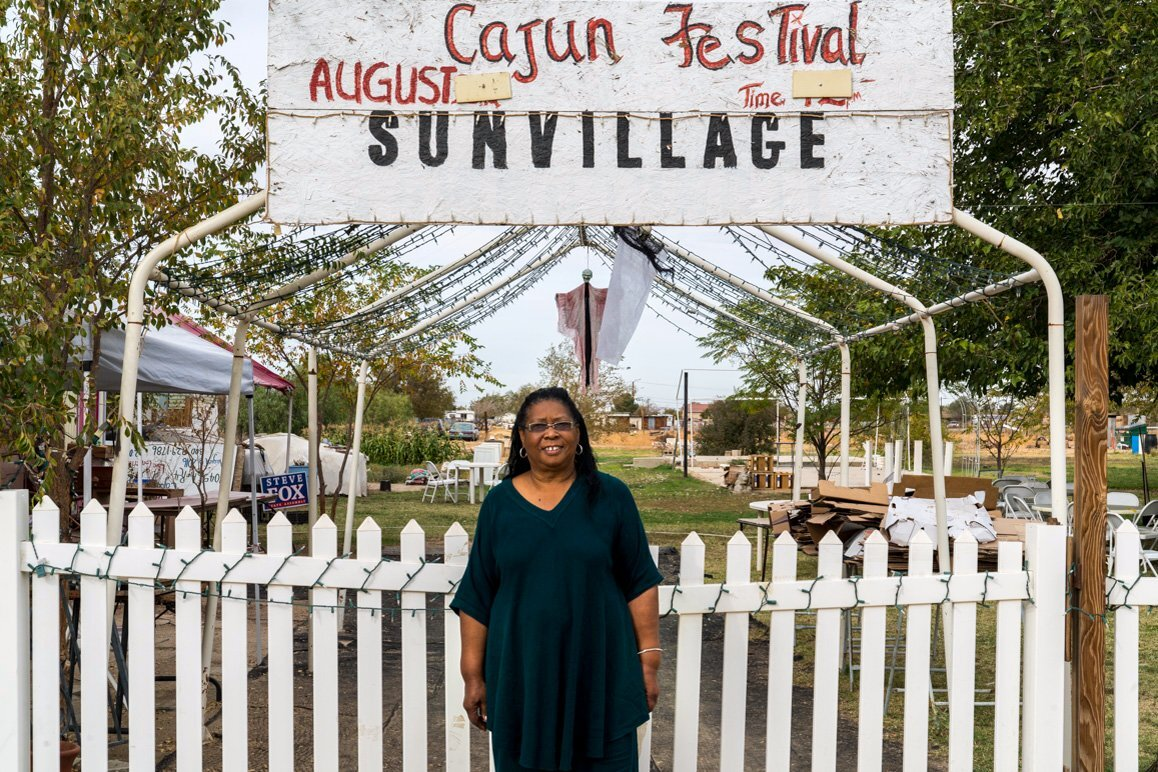 Sun Village's mayor Magdalene Lawrence at her home that alternatively serves as a community gathering space and is the site of a former historic African American church. | Kim Stringfellow © 2017.