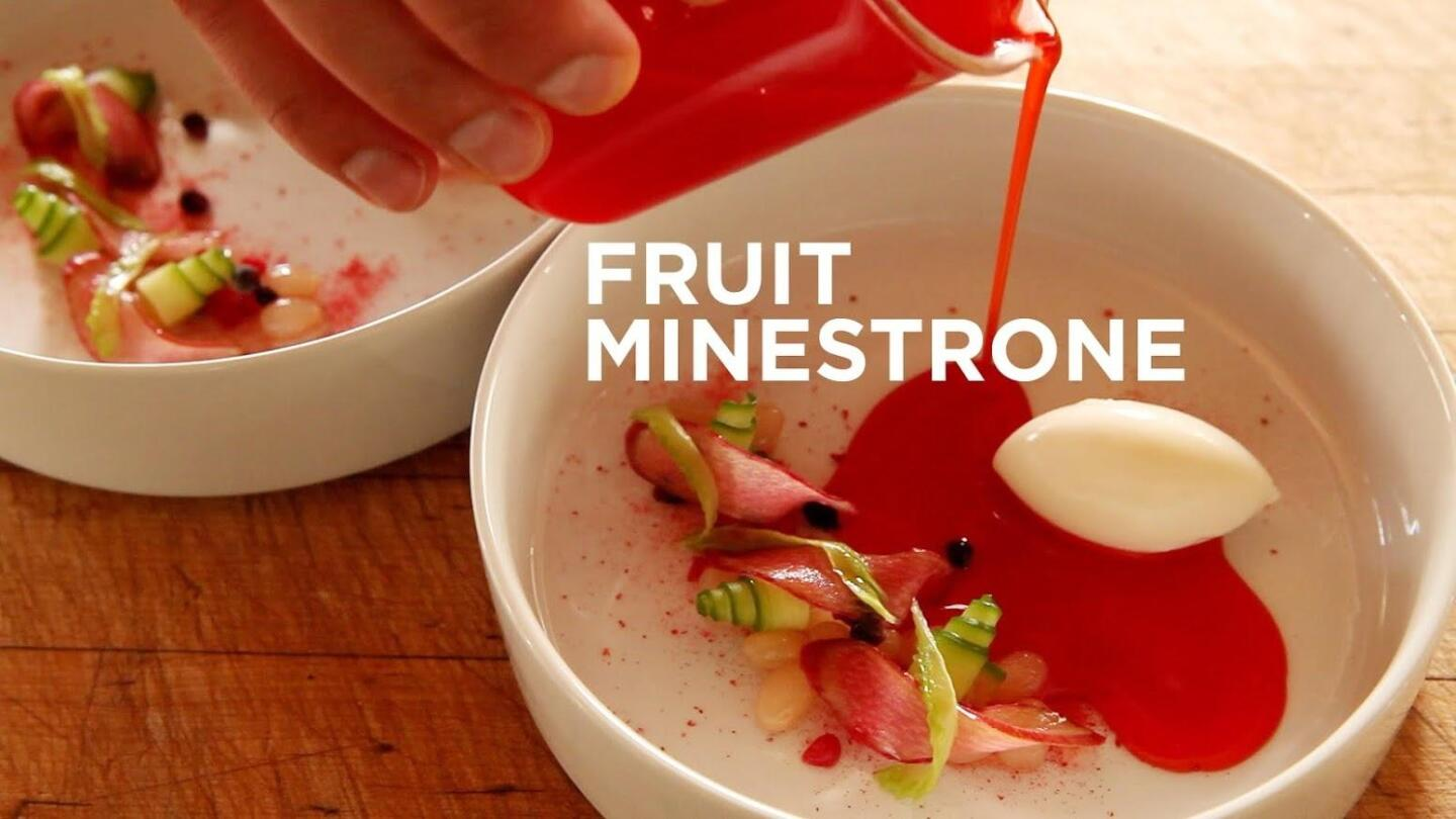 Someone preparing fruit minestrone in a bowl.