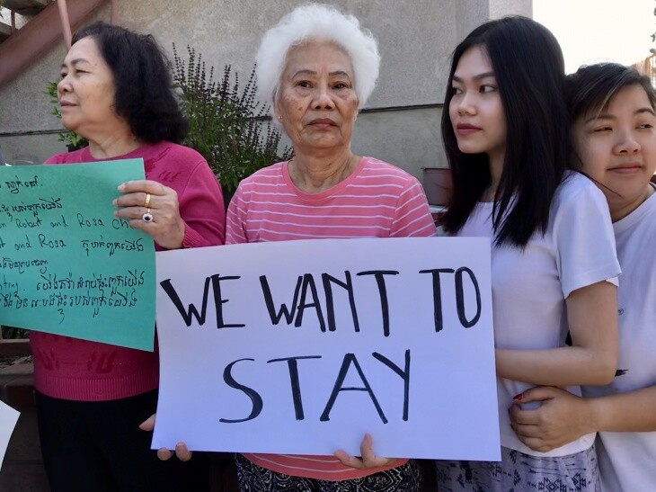 Dieu Pham, 70, takes part in an anti-eviction protest outside her apartment building in August 2019. A new owner is trying to evict the tenants now.   Josie Huang/LAist