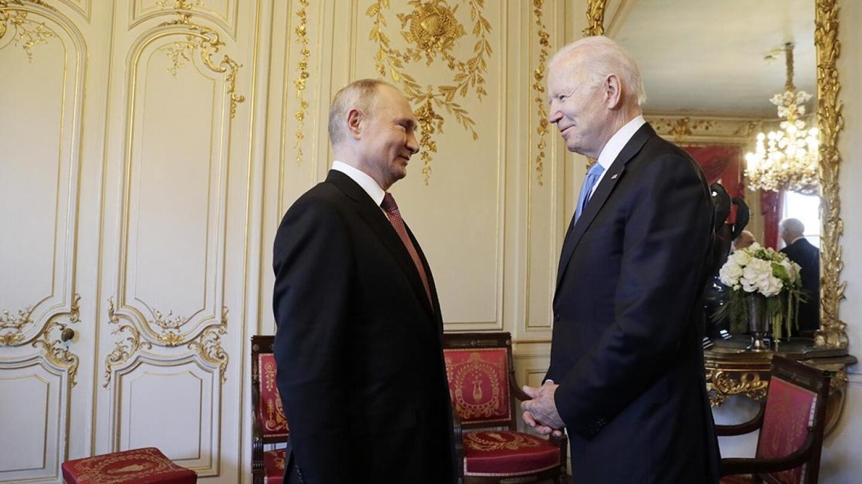 President Biden and President Putin face each other.