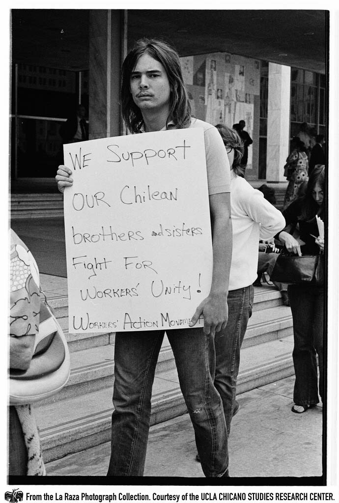 CSRC_LaRaza_B15F11C1_PA_018 Protesters at a demonstration against the Chilean  coup d'état outside of the L.A. Federal Building | Pedro Arias, La Raza photograph collection. Courtesy of UCLA Chicano Studies Research Center