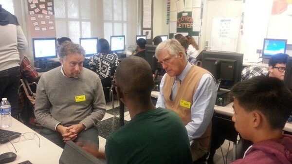 Two mentors meet with juniors to discuss their portfolios and resumes