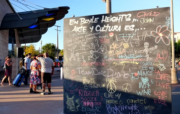 A community chalkboard was provided by Self-Help Graphics