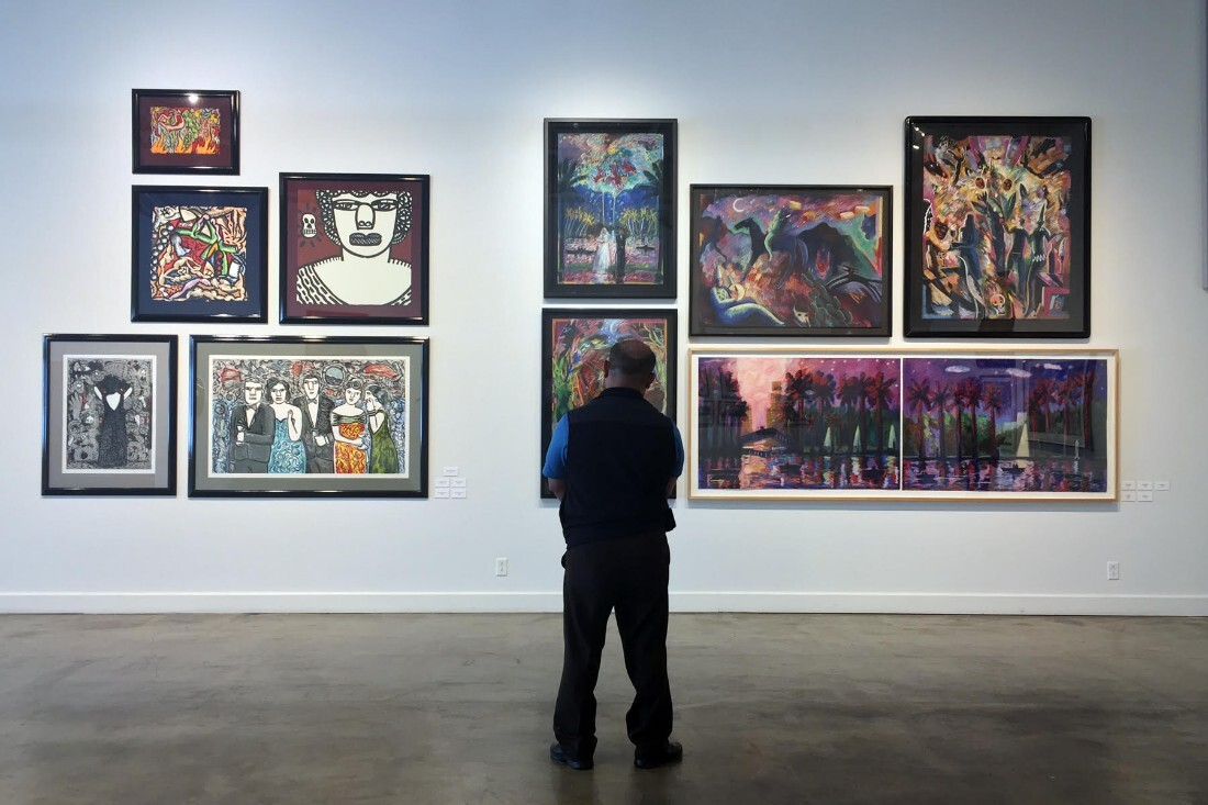 """Museum goer at """"Papel Chicano Dos: Works on Paper, from the Collection of Cheech Marin"""" 