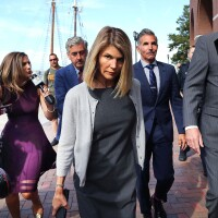 Lori Loughlin, center, and her husband Mossimo Giannulli, behind her at right, leave the John Joseph Moakley United States Courthouse in Boston on Aug. 27, 2019 | John Tlumacki/The Boston Globe/Getty Images