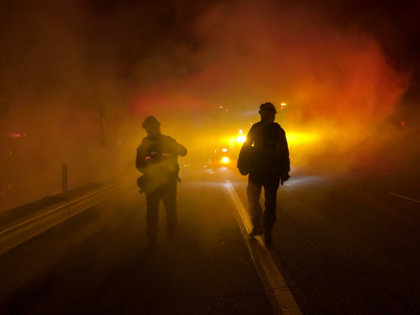 Members of Los Angeles County Fire personnel along PCH at Paradise Cove, early morning of November 10.