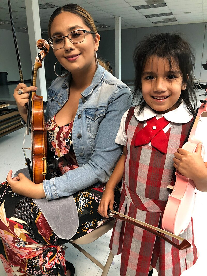 America Mata with a young student from her introduction to violin class. | Courtesy of Richard Mata