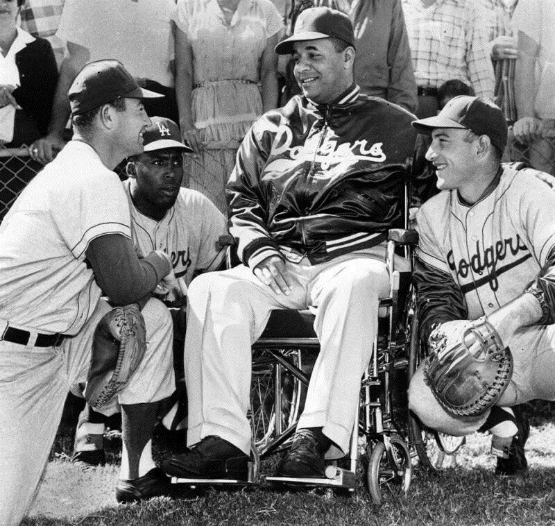 Catchers receive advice from former Dodger Roy Campanella. LA Herald Examiner Photo Collection, Los Angeles Public Library