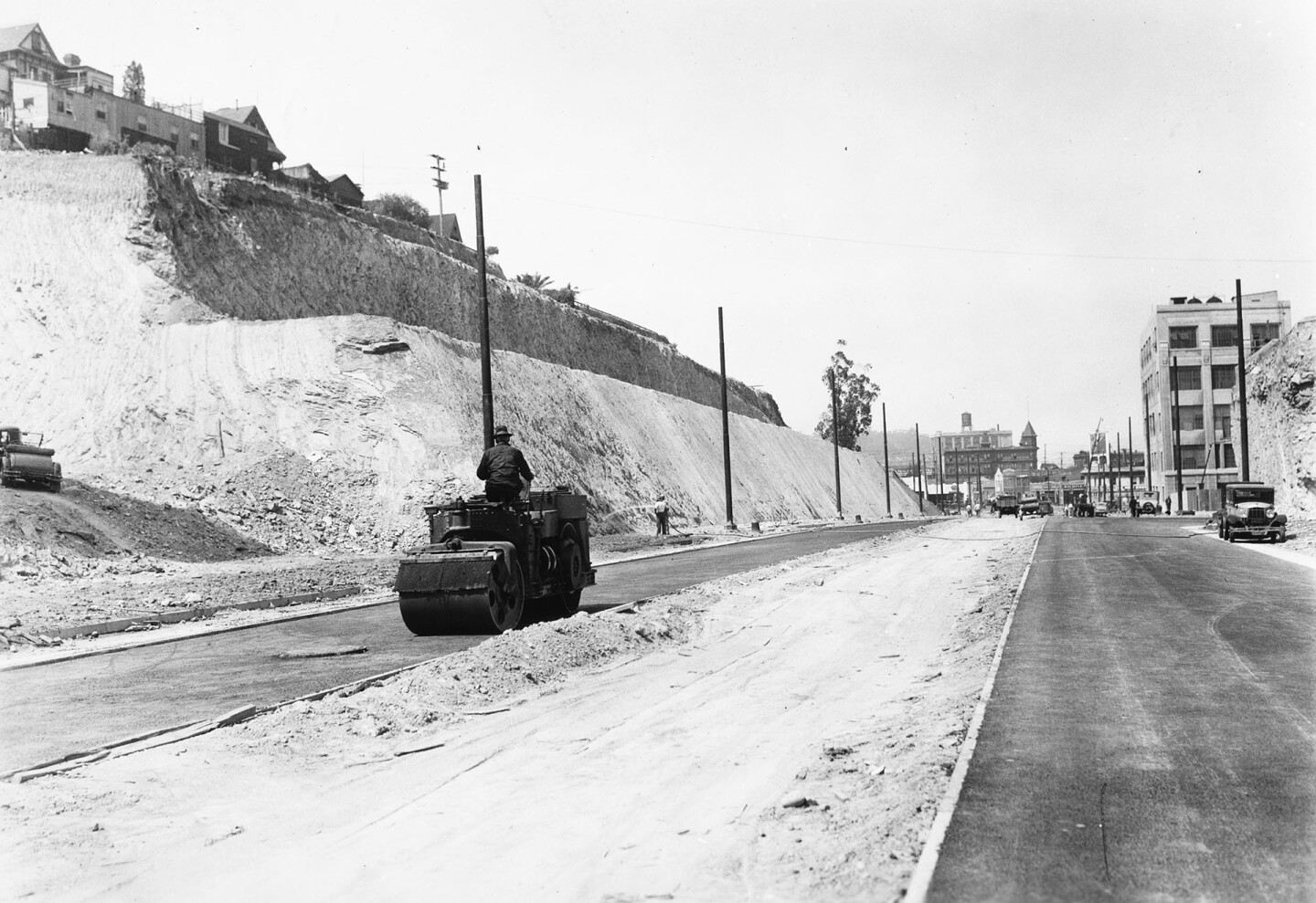 Workers trimmed back Fort Moore Hill to extend Spring Street, shown here circa 1935, northward. Courtesy of the USC Libraries - California Historical Society Collection.