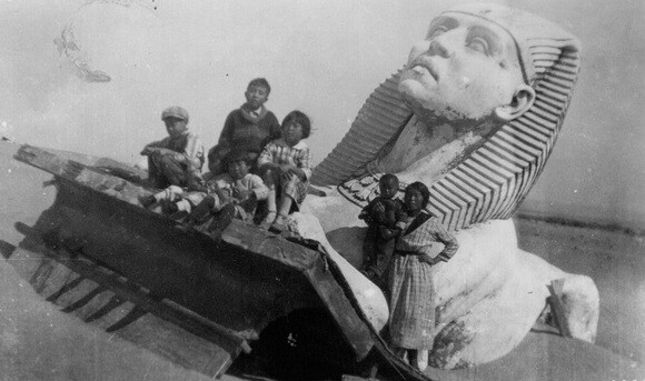 "Several members of the Nakamura family of Guadalupe stand on a set piece from Cecil B. DeMille's ""The Ten Commandments."" 