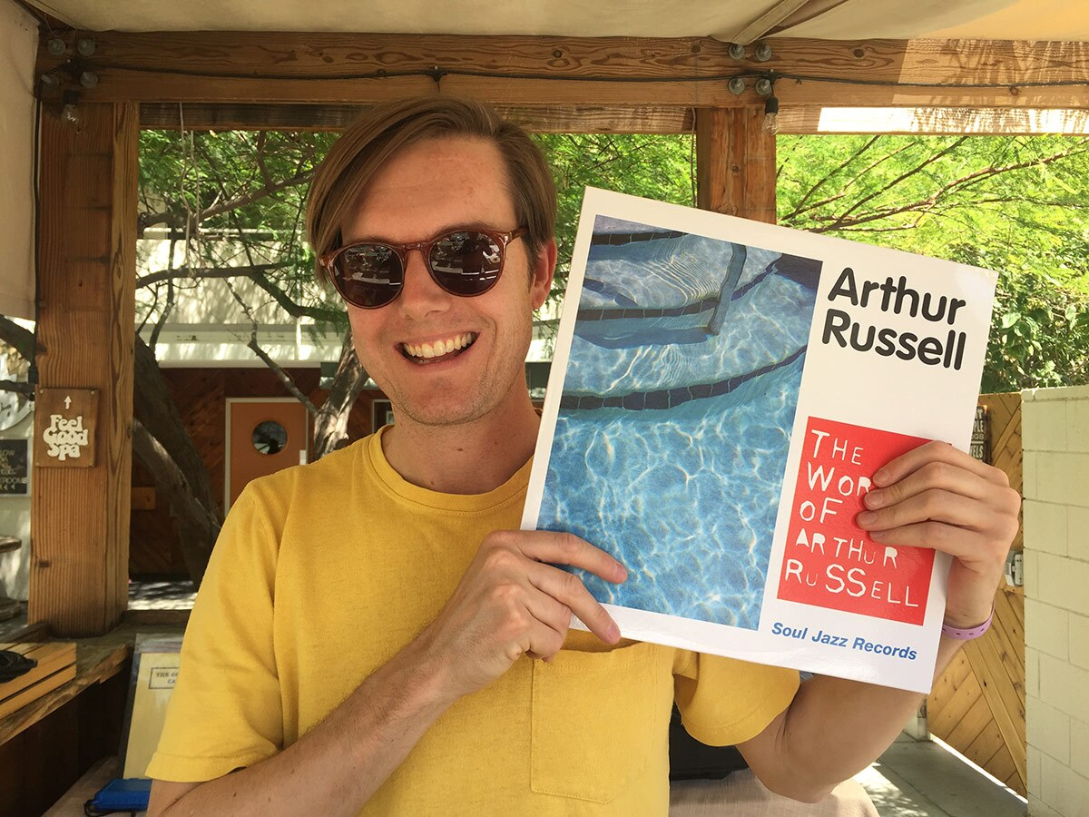 """Mark """"Frosty"""" McNeill holding """"The World of Arthur Russell"""" by Arthur Russell 