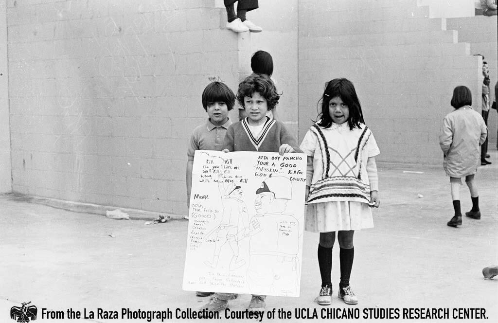 CSRC_LaRaza_B6F2aC5_PB_001 Children holding signs at March Por La Justicia Rally at Belvedere Park | Patricia Borjon Lopez, La Raza photograph collection. Courtesy of UCLA Chicano Studies Research Center