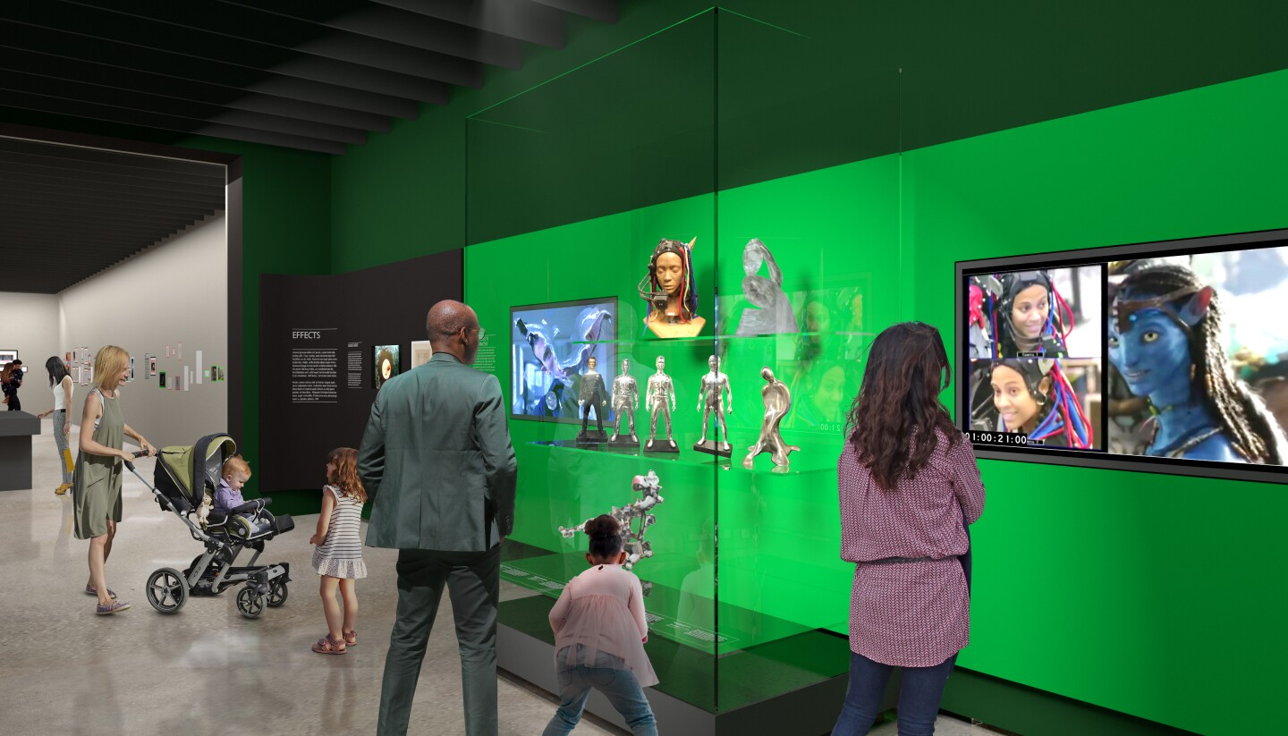 """A rendering of the effects gallery in the """"Stories of Cinema"""" exhibit at the Academy Museum of Motion Pictures set to open Sept. 30. The image depicts museum-goers viewing special effects pieces from James Cameron's 2009 film, """"Avatar."""""""
