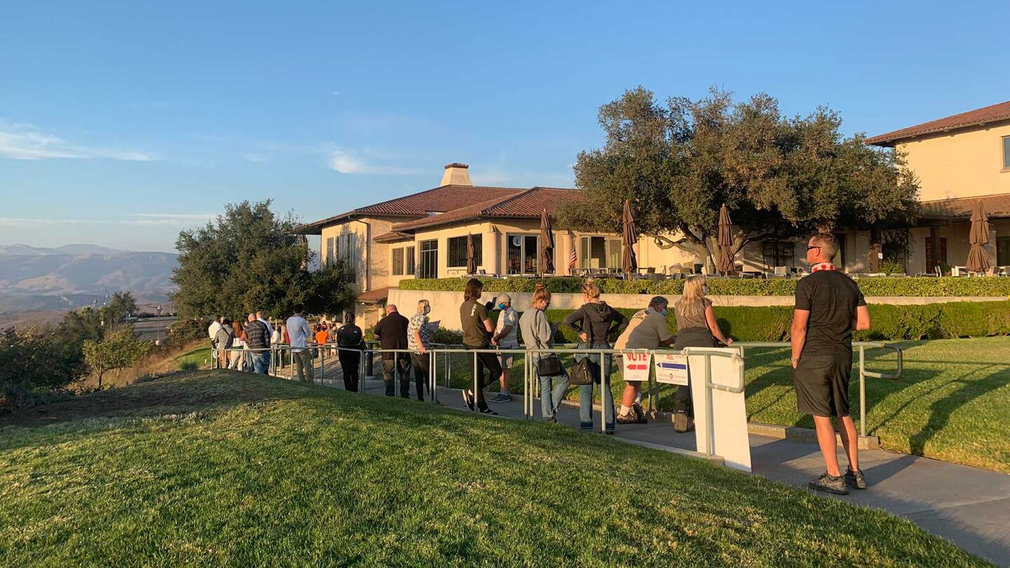 Voters wait in line at the Reagan Presidential Library in Simi Valley, CA.