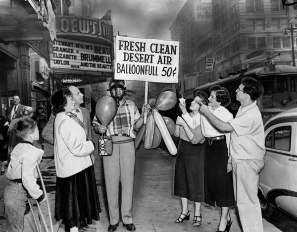 Man selling fresh clean desert air for 50 cents a balloonfull in front of Loew's State Theatre in Los Angeles, Oct. 22, 1954.  Herald-Examiner Collection photo courtesy of The Los Angeles Public Library