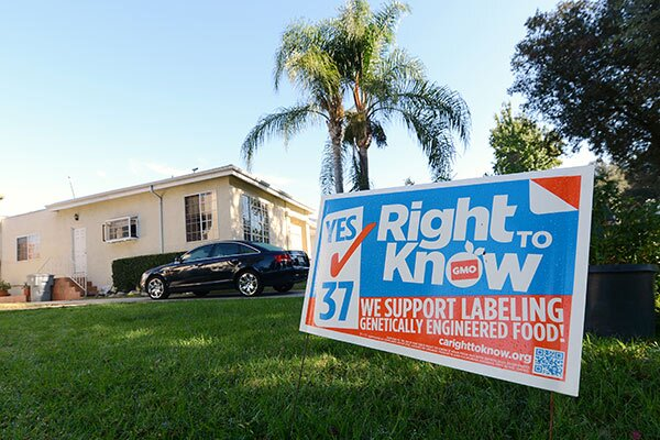 A sign supporting Proposition 37 which calls for the mandatory labeling of genetically engineered foods is seen in front of a home in Glendale, California October, 19, 2012. (Credit: ROBYN BECK/AFP/Getty Images)