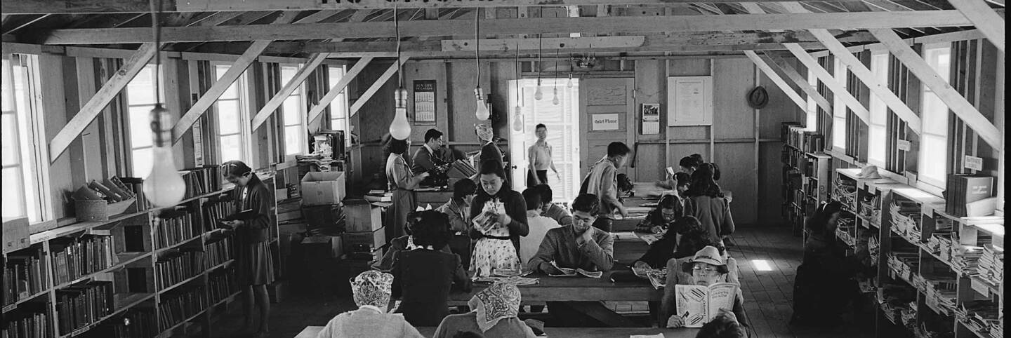 San Bruno, California. A barrack building at this assembly center has been reserved for the library which has just been established with a trained librarian of Japanese ancestry in charge.  US National Archives and Records Administration