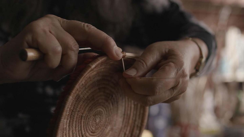 Linda Yamane (Rumsien Ohlone) weaves a coiled basket | Matthew Whalen