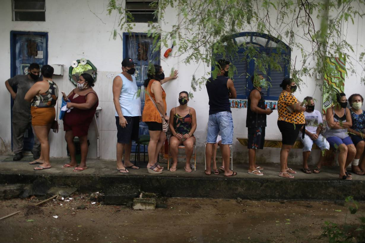 Residents wait in line to receive the Sinovac's CoronaVac coronavirus disease (COVID-19) vaccine at the community Quilombo Quilomba, descendants of African slaves, in Mage, Rio de Janeiro state, Brazil April 7, 2021.