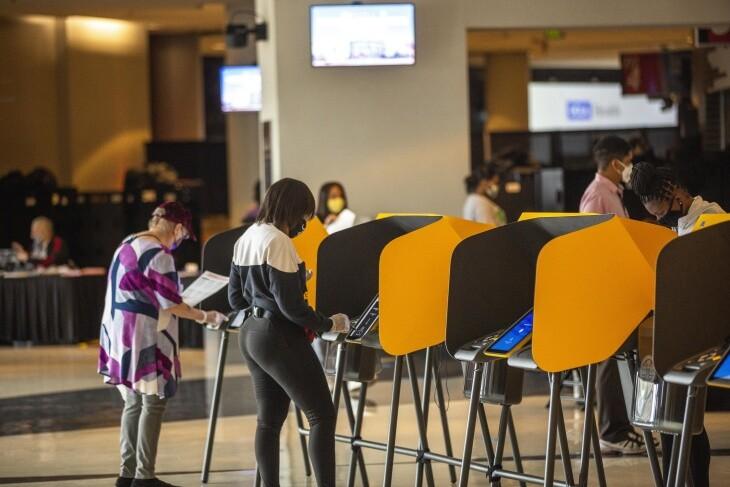 Voters cast their ballots at the vote center inside Staples Center.   Chava Sanchez/LAist