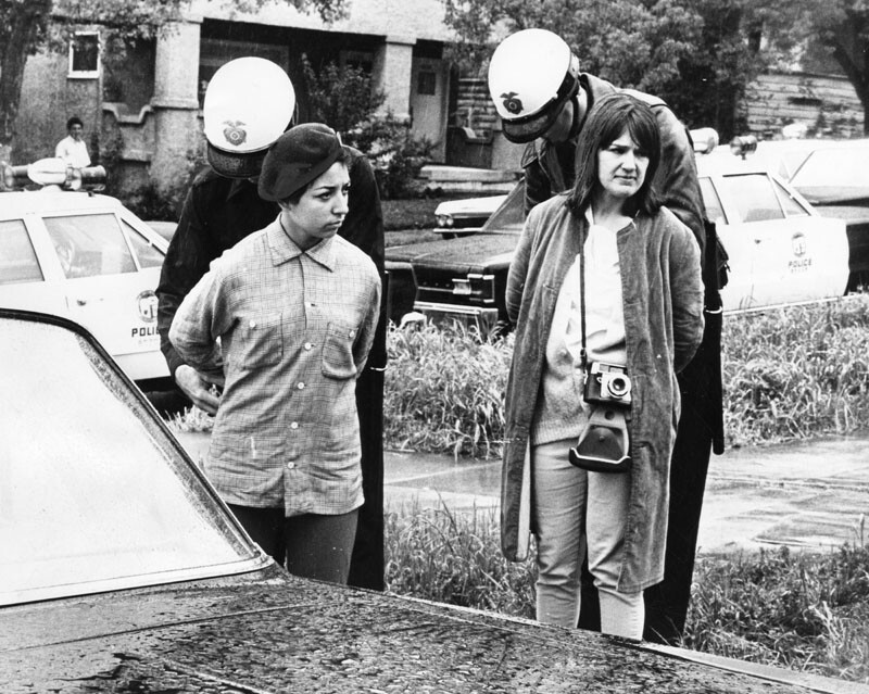 Police handcuff a Brown Beret and photographer from the Free Press outside Belmont High School, March 8th 1968. Photo Courtesy of the Los Angeles Public Library