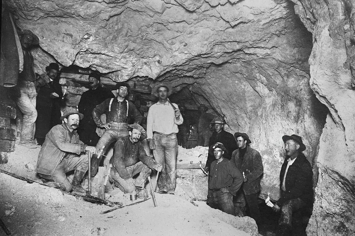 A group of miner's deep within Goldfield's Mohawk Mine (pictured here near an $80,000 gold ledge). | Charles C. Pierce. Courtesy of USC Libraries and California Historical Society.