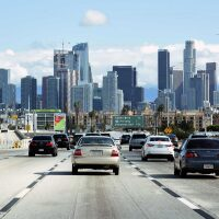View of mid-morning freeway commuters enjoy light traffic as they drive towards Downtown Los Angeles. March 20, 2020 | Bob Riha, Jr./Getty Images