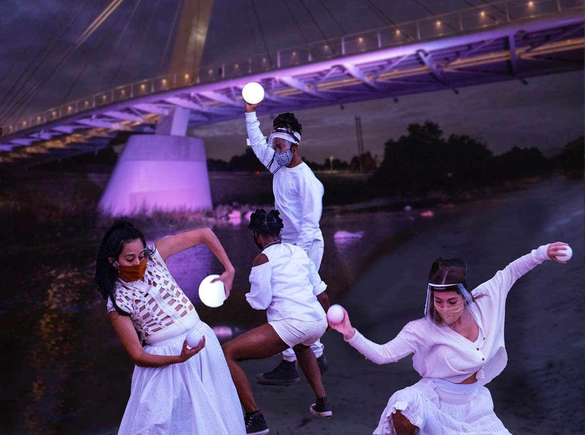 "Dancers at the North Atwater multi-modal bridge. The performance is part of at ""Firefly Nights,"" an in-person COVID-safe experience that falls within the ""Rio Reveals"" series."