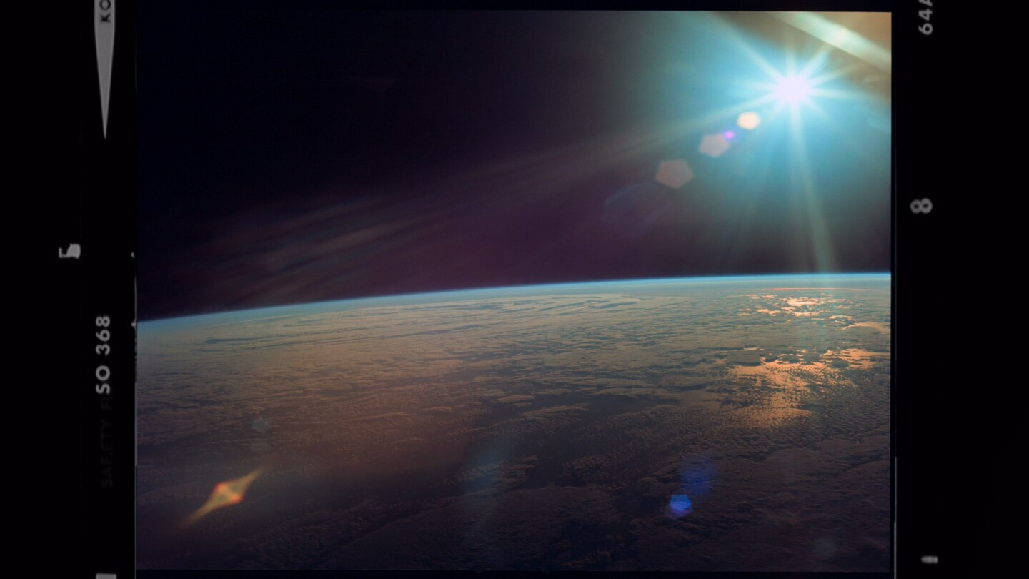 "A photographic image of the earth as seen from space | | Still from ""8 Days: To the Moon and Back"""